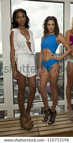 NEW YORK - AUGUST 21: Models wearing Rica Swimwear at the Rica Swimwear private preview for fashion week Spring/Summer 2013 on Rooftop at Mondrian Soho hotel in Manhattan on August 21, 2012 in NYC