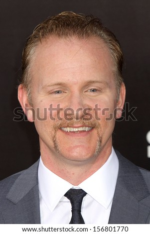 "NEW YORK - AUGUST 26:  Morgan Spurlock attends the premiere of ""One Direction This Is Us"" at the Ziegfeld Theater on August 26, 2013 in New York City. - stock photo"