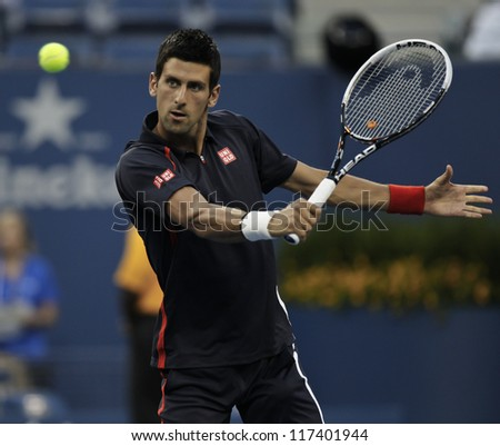 NEW YORK - AUGUST 28: Novak Djokovic of Serbia returns ball during 1st round match against Paolo Lorenzi of Italy at US Open tennis tournament on August 28, 2012 in Flushing Meadows New York - stock photo