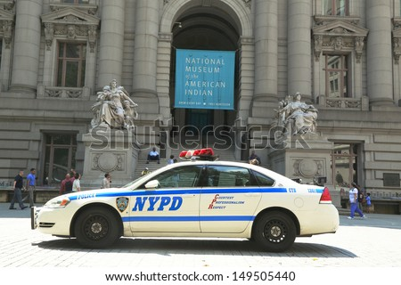 NEW YORK - AUGUST 6: NYPD car in the front of National Museum  of the American Indian in Manhattan on August 6, 2013  NYPD on high alert after terror threat in New York City - stock photo