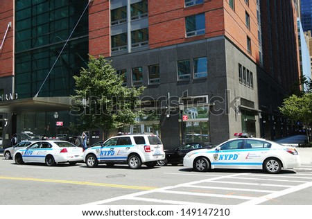 NEW YORK - AUGUST 6: NYPD on high alert after terror threat in New York City on August 6, 2013. Numerous NYPD cars providing security in World Trade Center area of  Manhattan  - stock photo