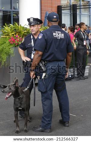NEW YORK - AUGUST 23: NYPD transit bureau K-9 police officers and K-9 dog Sam  providing security at National Tennis Center during US Open 2014 on August 23, 2014 in New York