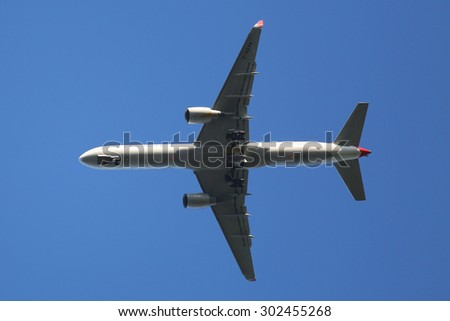 NEW YORK - AUGUST 2, 2015: OpenSkies Boeing 757 descending for landing at JFK International Airport in New York. OpenSkies is a transatlantic airline owned by British Airways - stock photo