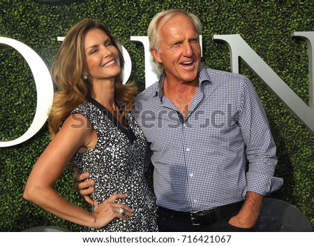 NEW YORK - AUGUST 28, 2017: Professional golfer and entrepreneur Greg Norman and Kirsten Kutner on the blue carpet before US Open 2017 opening night ceremony at Tennis Center in New York