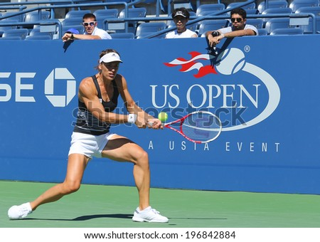 NEW YORK - AUGUST 24: Professional tennis player Andrea Petkovic from Germany  practices for US Open 2013 at Billie Jean King National Tennis Center on August 24, 2013 in Flushing, NY - stock photo
