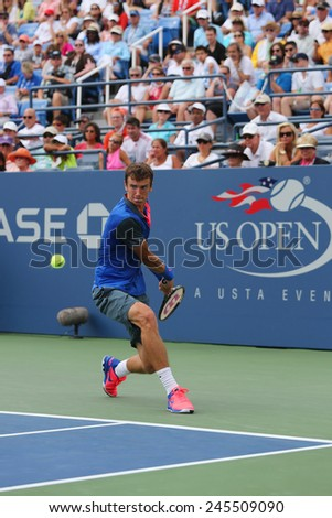 NEW YORK - AUGUST 30, 2014: Professional tennis player Andrey Kuznetsov from Russia during US Open 2014 round 3 match against Andy Murray at Billie Jean King National Tennis Center in New York - stock photo