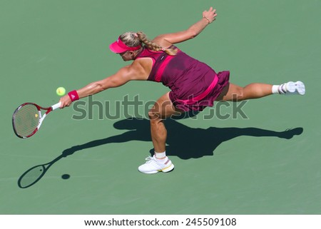 NEW YORK - AUGUST 25, 2014:  Professional tennis player Angelique Kerber from Germany during first round match at US Open 2014 against Ksenia Pervak in New York  - stock photo