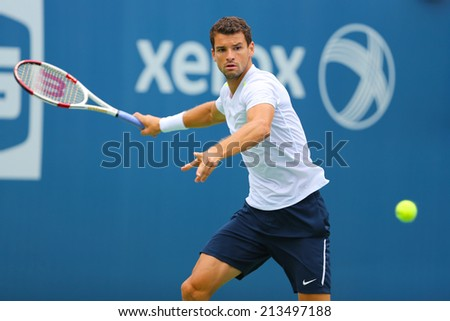 NEW YORK - AUGUST 23: Professional tennis player Grigor Dimitrov from Bulgaria practices for US Open 2014 at Billie Jean King National Tennis Center on August 23 , 2014 in New York  - stock photo