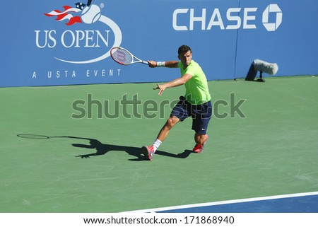 NEW YORK - AUGUST 24 Professional tennis player Grigor Dimitrov from Bulgaria practices for US Open 2013 at Billie Jean King National Tennis Center on August 24, 2013 in New York - stock photo
