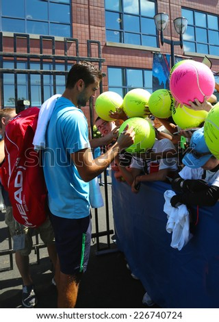 NEW YORK - AUGUST 28 Professional tennis player Marin Cilic signing autographs after practice for US Open 2014 at Billie Jean King National Tennis Center on August 28, 2014 in New York - stock photo