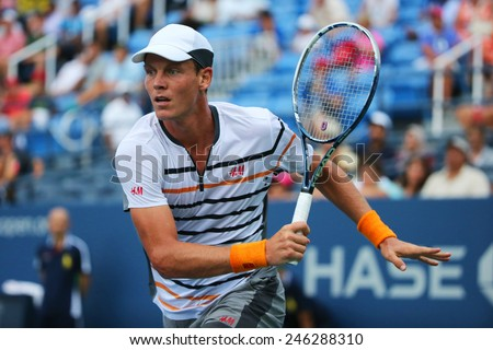 NEW YORK - AUGUST 31, 2014: Professional tennis player Tomas Berdych from Czech Republic during US Open 2014 round 3 match against Teymuraz Gabashvili at Billie Jean King National Tennis Center - stock photo