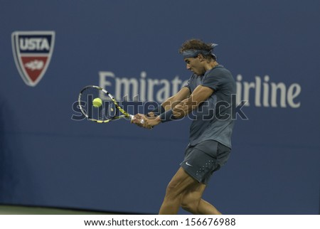 NEW YORK - AUGUST 29: Rafael Nadal of Spain returns ball during 2nd round match against Rogerio Dutra Silva of Brazil at 2013 US Open at USTA Billie Jean King Tennis Center on August 29, 2013 in NYC - stock photo