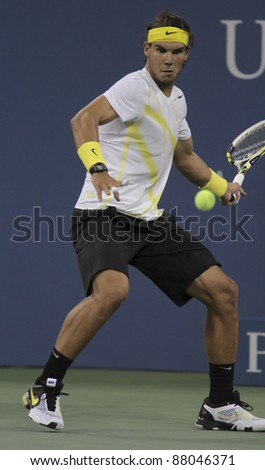 NEW YORK - AUGUST 30: Rafael Nadal of Spain returns ball during 1st round match against Andrey Golubev of Kazakhstan at USTA Billie Jean King National Tennis Center on August 30, 2011 in NYC - stock photo