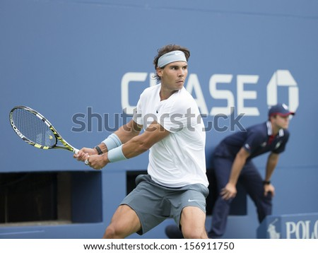NEW YORK - AUGUST 26: Rafael Nadal of Spain returns ball during 1st round match against Ryan Harrison of USA at 2013 US Open at USTA Billie Jean King Tennis Center on August 26, 2013 in NYC