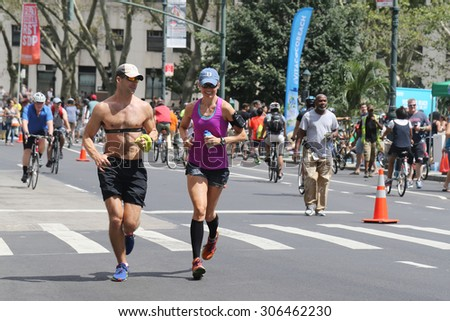 NEW YORK - AUGUST 8, 2015: Runners during Summer Streets Saturday in New York. Summer Streets is an annual celebration of New York City's most valuable public space our streets