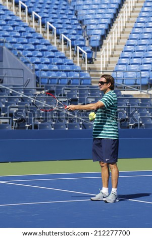NEW YORK - AUGUST 19: Sam Sumyk, the coach of two times Grand Slam champion Victoria Azarenka during practice for US Open 2014 at  National Tennis Center on August 19 , 2014 in New York  - stock photo