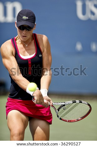 NEW YORK - AUGUST 31: Samantha Stosur of Australia returns a shot during 1st round match against Ai Sugiyama of Japan at US Open on August 31 2009 in New York