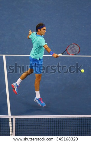 NEW YORK - AUGUST 31, 2014: Seventeen times Grand Slam champion Roger Federer during third round match at US Open 2014 at Billie Jean King National Tennis Center in New York  - stock photo