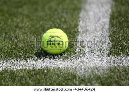 NEW YORK - AUGUST 6, 2015: Slazenger Wimbledon Tennis Ball on grass tennis court. Slazenger Wimbledon Tennis Ball exclusively used and endorsed by The Championships, Wimbledon - stock photo