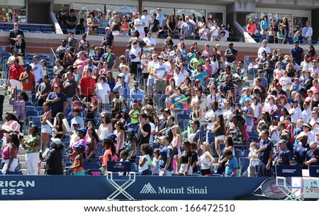 NEW YORK -AUGUST 24 Spectators standing at Arthur Ashe Stadium for American anthem performance during opening ceremony for Arthur Ashe Kids Day 2013 at  National Tennis Center on August 24, 2013 in NY - stock photo