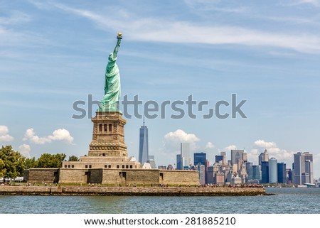 NEW YORK - AUGUST 2014: Statue of Liberty on Liberty Island in New York Harbor with Manhattan skyline on August 11, 2014. Statue of Liberty is one of the most recognizable landmarks of New York City. - stock photo