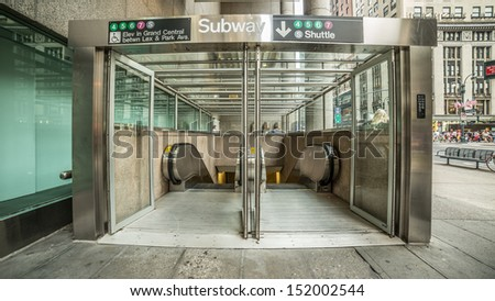 NEW YORK - AUGUST 20: subway entrance on August 20, 2013 in New York. The NYC Subway is a rapid transit system owned by the City of New York and leased to the New York City Transit Authority. - stock photo