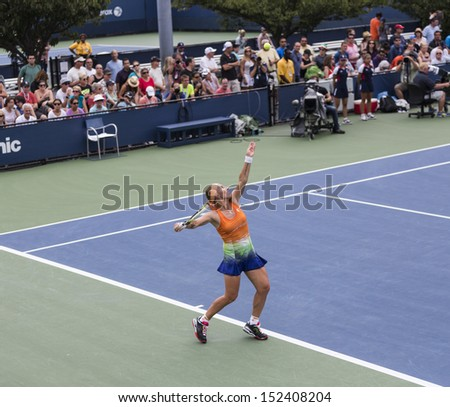 NEW YORK - AUGUST 31: Svetlana Kuznetsova of Russia returns ball during 3rd round match against Flavia Pennetta of Italy at 2013 US Open at USTA Billie Jean King Tennis Center on August 31 2013 in NYC