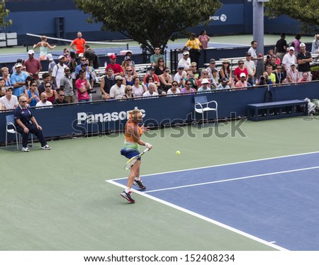 NEW YORK - AUGUST 31: Svetlana Kuznetsova of Russia returns ball during 3rd round match against Flavia Pennetta of Italy at 2013 US Open at USTA Billie Jean King Tennis Center on August 31 2013 in NYC - stock photo