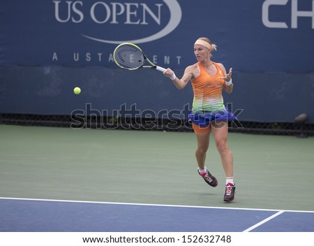 NEW YORK - AUGUST 31: Svetlana Kuznetsova of Russia returns ball during 3rd round match against Flavia Pennetta of Italy at 2013 US Open at USTA Billie Jean King Tennis Center on August 31, 2013 in NYC - stock photo