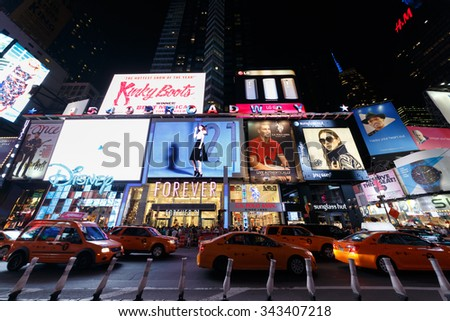 NEW YORK - August 23, 2014: taxis and billboards on Broadway at night