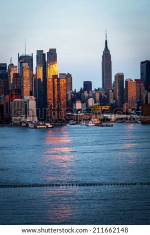 NEW YORK-AUGUST 10-The sunsets off the New York City skyline along the Hudson River on August 10 2014 in New York City. - stock photo
