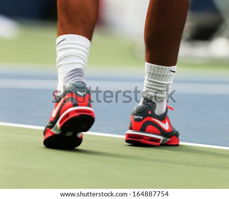 NEW YORK - AUGUST 27 Twelve times Grand Slam champion Rafael Nadal wears custom Nike tennis shoes during practice for US Open 2013 at Billie Jean King National Tennis Center on August 27, 2013 in NY - stock photo