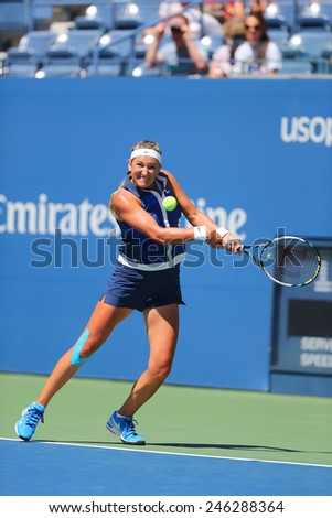 NEW YORK - AUGUST 28, 2014: Two times Grand Slam champion Victoria Azarenka from Belarus during second round match at US Open 2014 against Christina McHale at Billie Jean King National Tennis Center  - stock photo