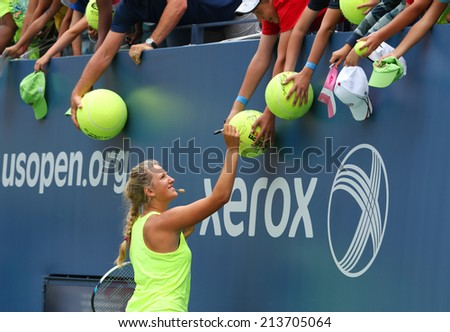 NEW YORK - AUGUST 21 Two times Grand Slam champion Victoria Azarenka signing autographs after practice for US Open 2014 at Billie Jean King National Tennis Center on August 21, 2014 in New York  - stock photo