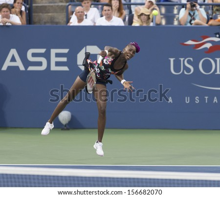NEW YORK - AUGUST 28: Venus Williams of USA returns ball during 2nd round match against Jie Zheng of China at 2013 US Open at USTA Billie Jean King Tennis Center on August 28, 2013 in New York