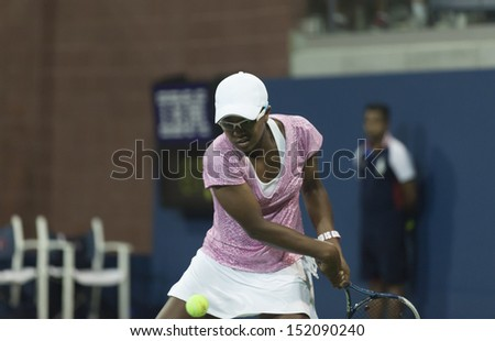 NEW YORK - AUGUST 29: Victoria Duval of USA returns ball during 2nd round match against Daniela Hantuchova of Slovakia at 2013 US Open at USTA Billie Jean King Tennis Center on August 29, 2013 in NYC - stock photo