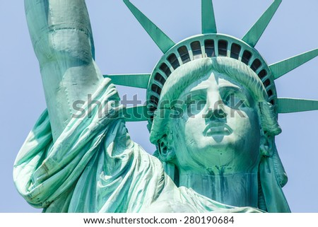 NEW YORK - AUGUST 2014: View of Statue of Liberty face on August 11, 2014 in Manhattan, NY. Statue of Liberty is one of the most recognizable landmark of New York City and one of the symbols of USA. - stock photo