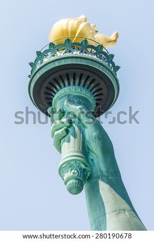 NEW YORK - AUGUST 2014: View on Statue of Liberty torch on August 11, 2014 in Manhattan, NY. Statue of Liberty is one of the most recognizable landmark of New York City and one of the symbols of USA. - stock photo