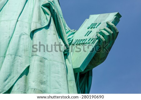 NEW YORK - AUGUST 2014: View on stone tablet held by Statue of Liberty on August 11, 2014 in Manhattan, NY. Statue of Liberty is one of the most recognizable landmark of New York City. - stock photo