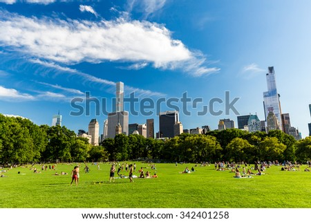 NEW YORK - AUGUST 22: Views of the from the big meadow Central Park to Midtown New York on August 22, 2015. The Central Park is a famous Park in the centre of Manhattan, New York. - stock photo