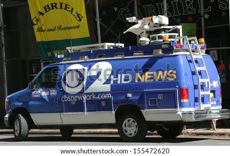 NEW YORK - AUGUST 15: WCBS Channel 2 van in midtown Manhattan on August 15, 2013. WCBS is a television station located in New York City and is the flagship station of the television network - stock photo
