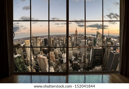 NEW YORK - AUGUST 30, 2013: window view of Manhattan in New York. Manhattan is the smallest NYC borough yet contains some of the world's most expensive real estate.  - stock photo