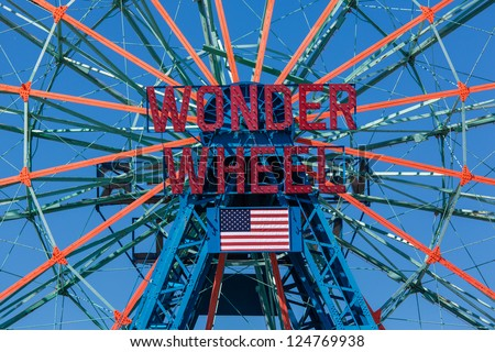 NEW YORK - AUGUST 25: Wonder Wheel located at Deno's Wonder Wheel Amusement Park in Coney Island NY on August 25, 2012. Wonder Wheel was build in 1920 and was declared a historic landmark in 1989 - stock photo