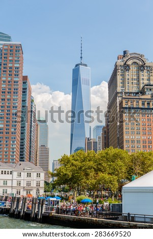NEW YORK - AUGUST 11: World Trade Center and surrounding buildings on August 11, 2014 in Manhattan, NY. Manhattan is one of the worlds leading cultural and economic centers.