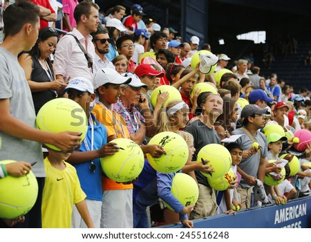 NEW YORK - AUGUST 30, 2014: Young tennis fans waiting for autographs at Billie Jean King National Tennis Center in New York. US Open is a final Grand Slam tournament of the year - stock photo