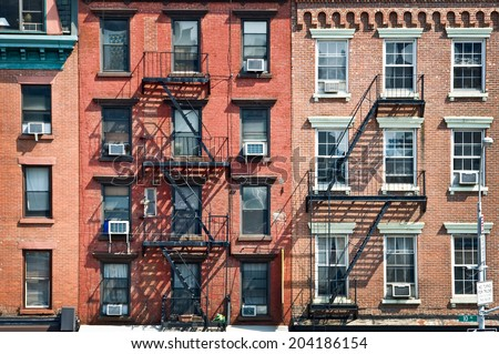 New York brick buildings with outside fire escape stairs, USA - stock photo