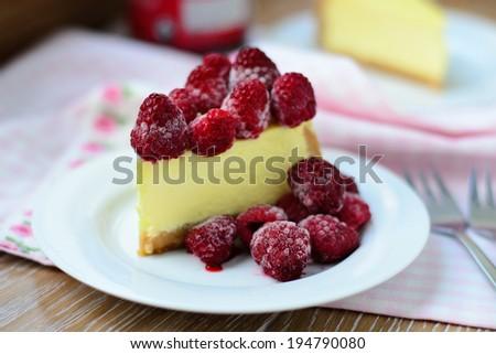 New York Cheesecake with frozen raspberries - stock photo