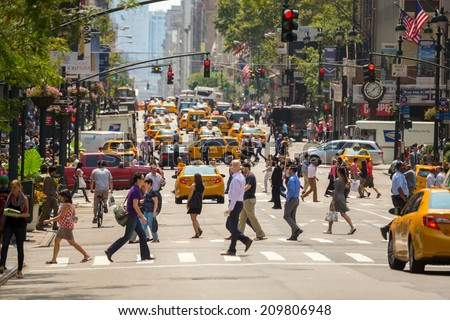 NEW YORK - CIRCA AUGUST 2014: Crowd of people pedestrians walking crossing street - stock photo