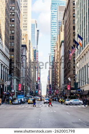 New York, circa dec 2014:Typical street view of building, people and car in Manhattan, - stock photo