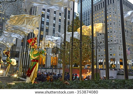 NEW YORK - CIRCA DECEMBER 2015. The Christmas Tree at Rockefeller Center is one of the most popular tourist draws during the holidays, attracting millions of visitors from around the world. - stock photo